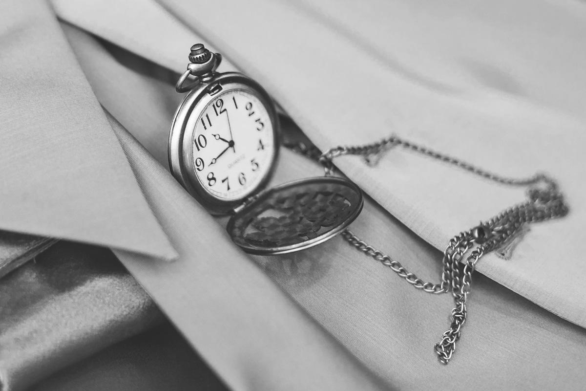 opened pocket watch on a shirt