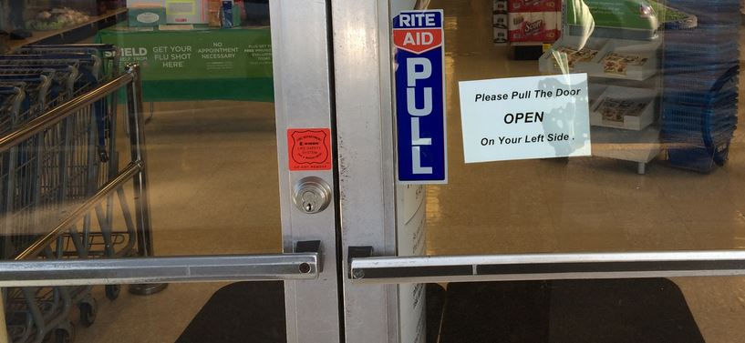 Sign on right door of two-door entrance with the words, Please pull the door open on your left side.