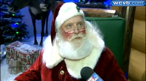 Santa Claus being interviewed about signing