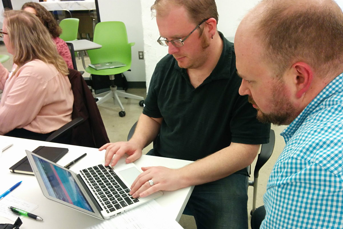 Two Refresh Detroit members using VoiceOver screen reader during hands-on session