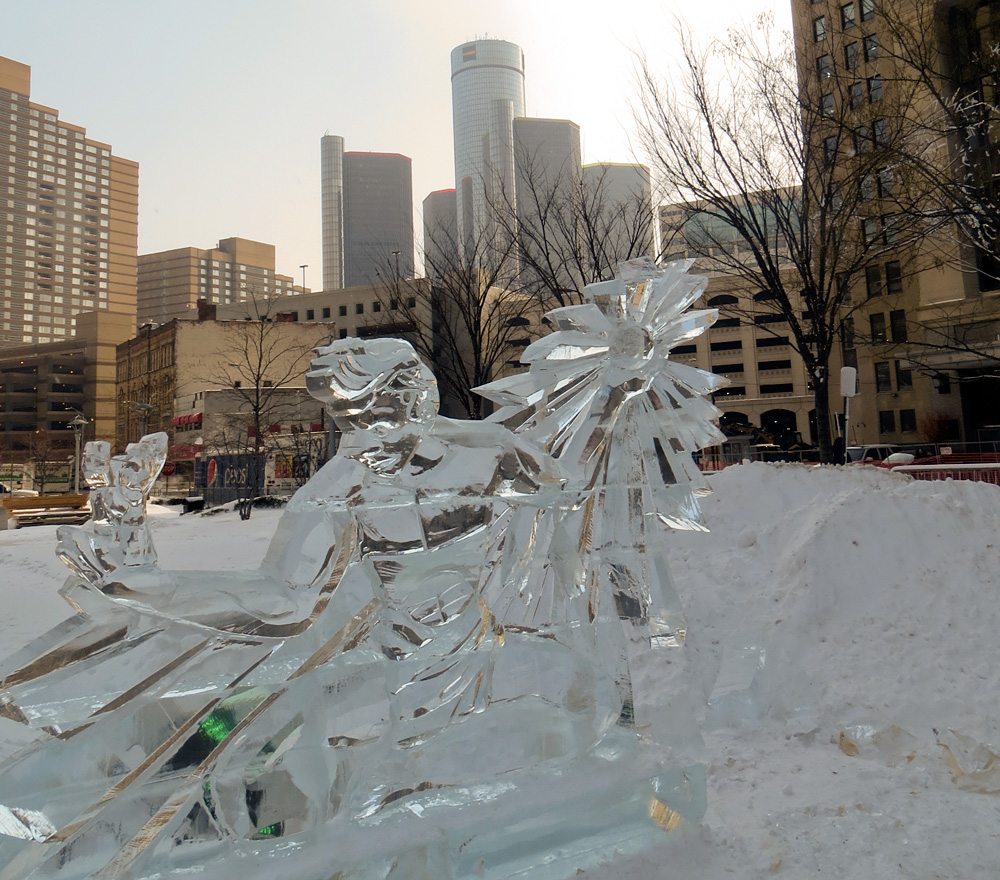 Spirit of Detroit ice sculpture with the Renaissance Center in the background in downtown Detroit