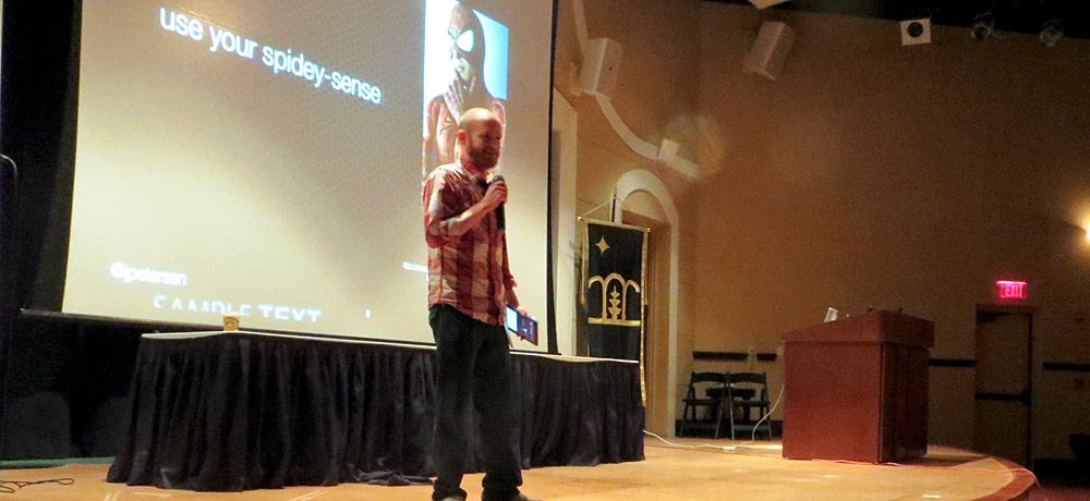 Jesse Petersen speaking on stage to WordCamp Orlando 2013 attendees