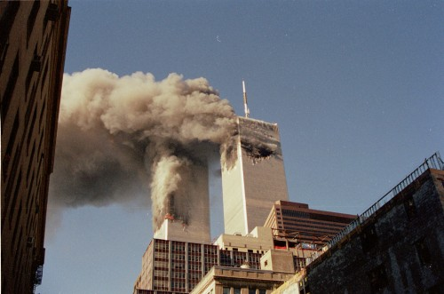 Twin towers of the World Trade Center with smoke bellowing out on September 11