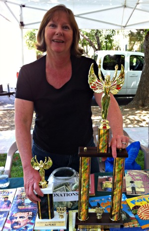 Volunteer with Winters Friends of the Library Youth Day Parade Trophy