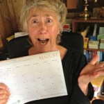 Lisa Nalbone looking scared holding August calendar