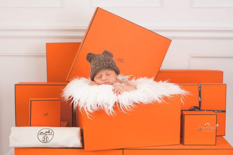 newborn in Hermes boxes