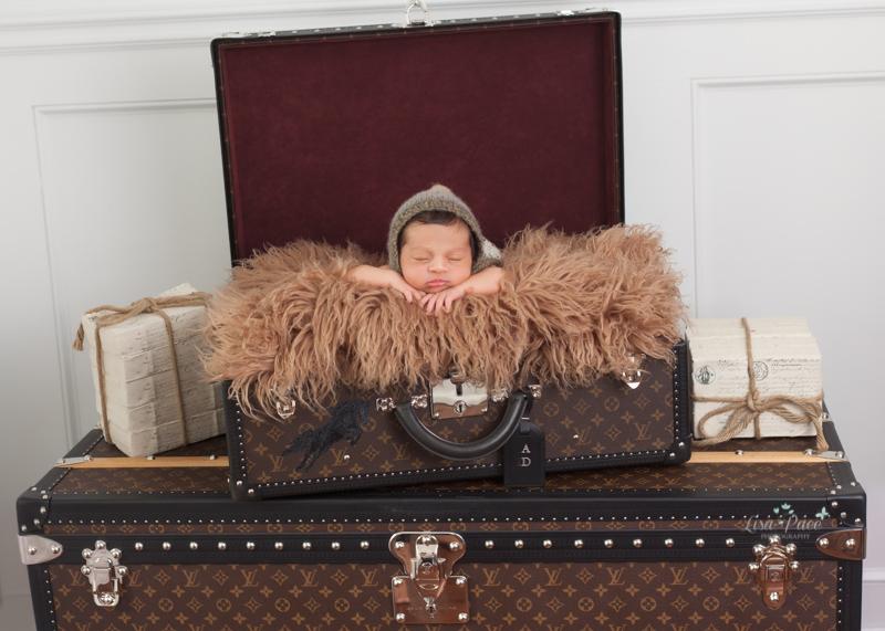 baby boy in luggage