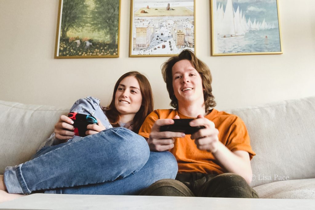 a couple playing a video game using controllers