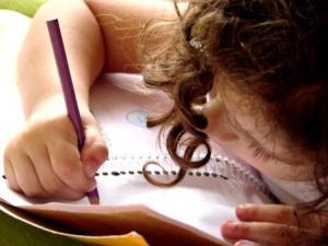 photo of child writing