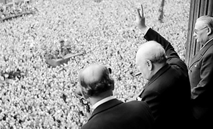 Churchill waving at crowds
