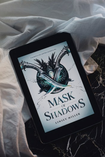 mask of shadows literary alliteration