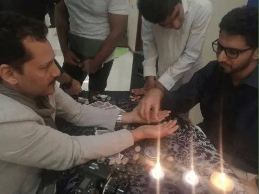Nisar Sufi Conducting a Palmistry Session in Dubai (December 2016)