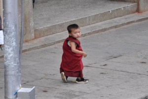 A young monk turns to the camera on the streets of Thimphu.