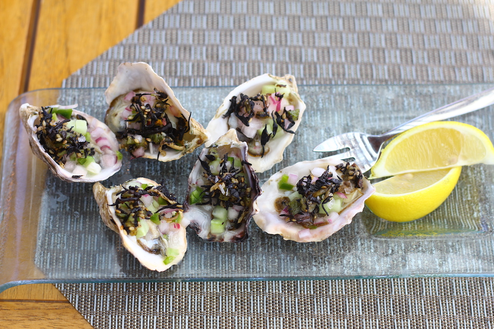 Kusshi oysters with cucumber, cured red onion, wakame and  maldon salt.