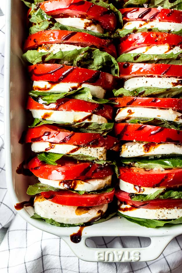 Light and easy appetizer or side dish, loaded with tomatoes, fresh mozzarella, and basil with a sweet balsamic reduction | https://www.littlebroken.com @littlebroken
