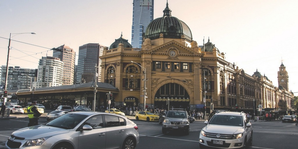 Melbourne's Flinder Street Station and busy city traffic | Little City Trips Guide to Getting Around Melbourne