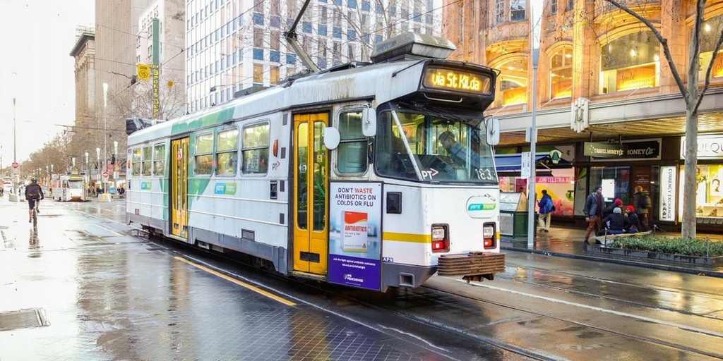 A Melbourne tram on a wet day   Little City Trips Guide how to get around Melbourne