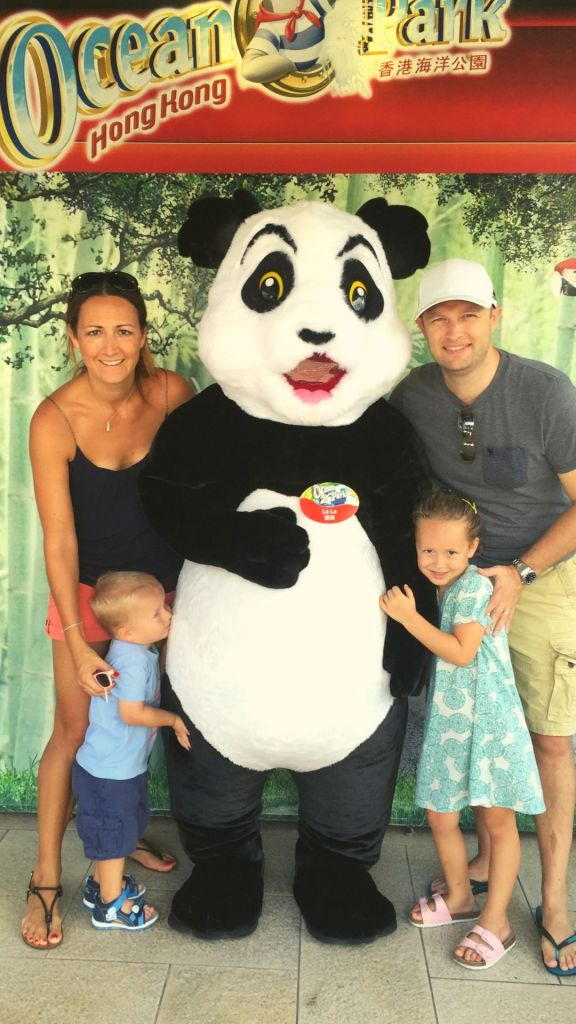 Family with dress up Panda Ocean Park