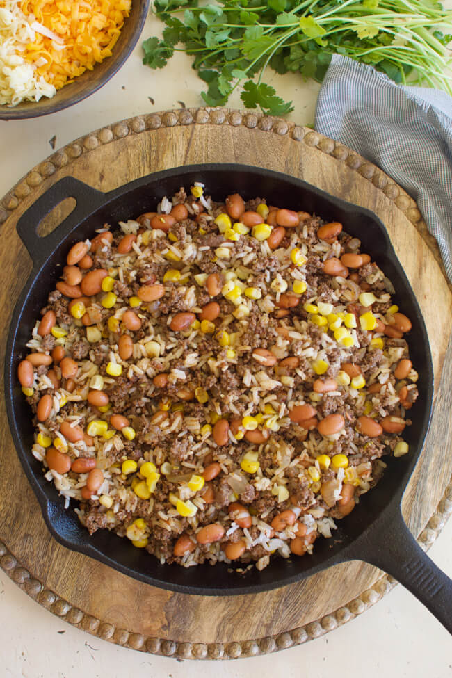 ground beef and bean burrito filling in a cast iron skillet