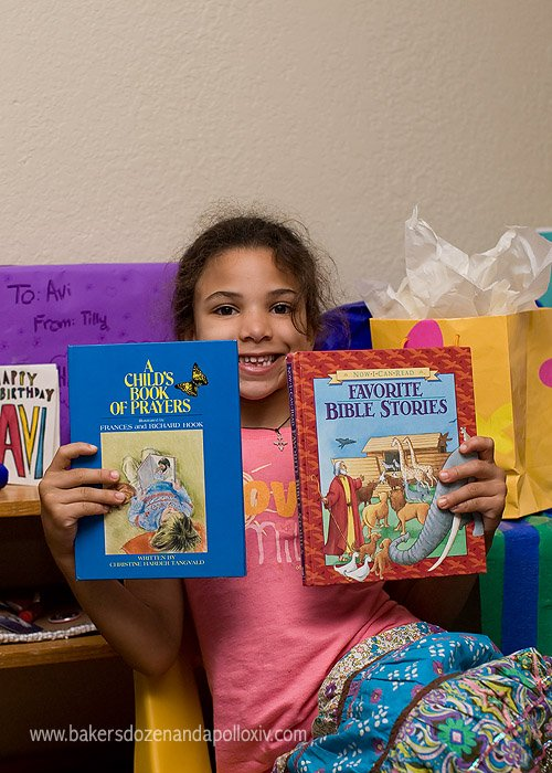 Avi with her birthday books.