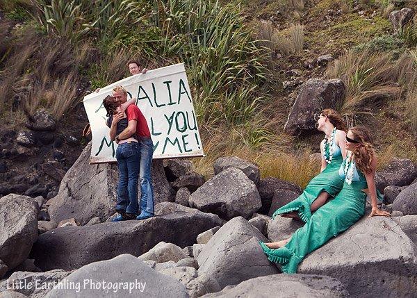 Kiwi man has friends dress up as mermaids so he can propose to girlfriend.