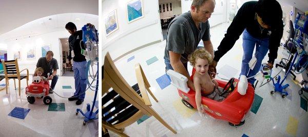 Boy in toy car in hospital