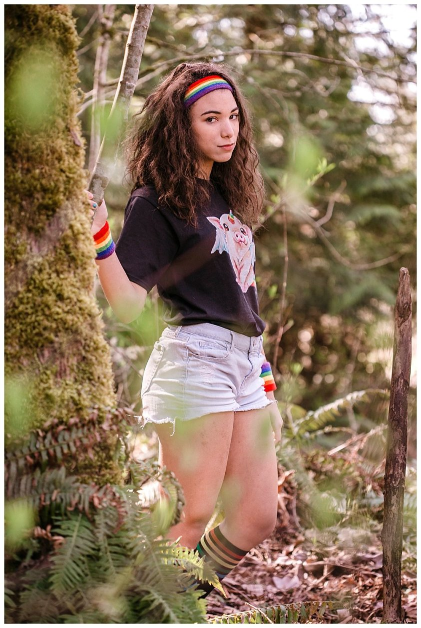 Dark rainbow Avi posing in woods.