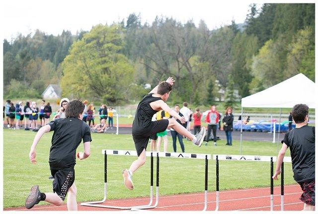 Tucker giong over hurdles.