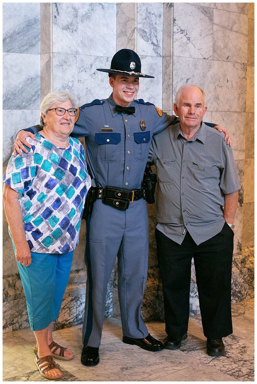 Judah with grandparents at graduation.
