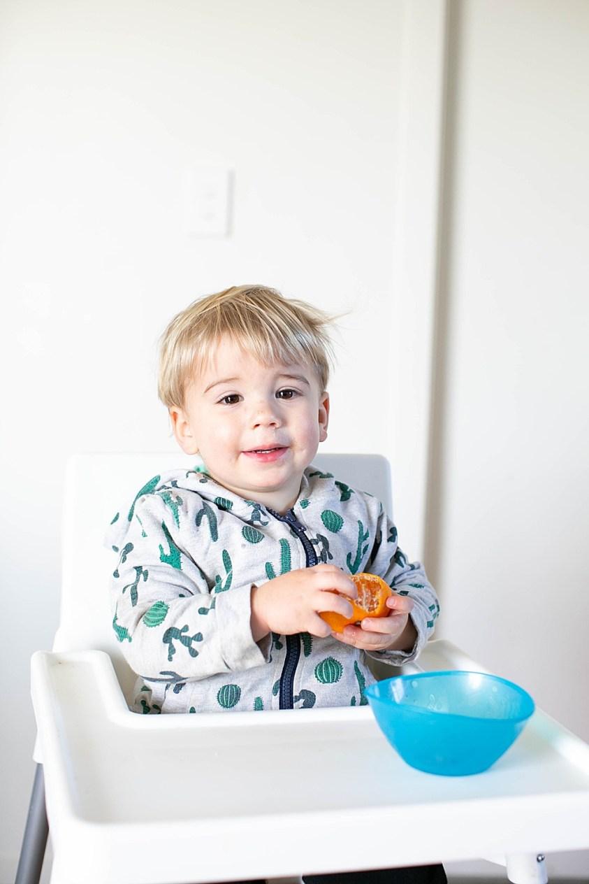 Percy peeling an orange.