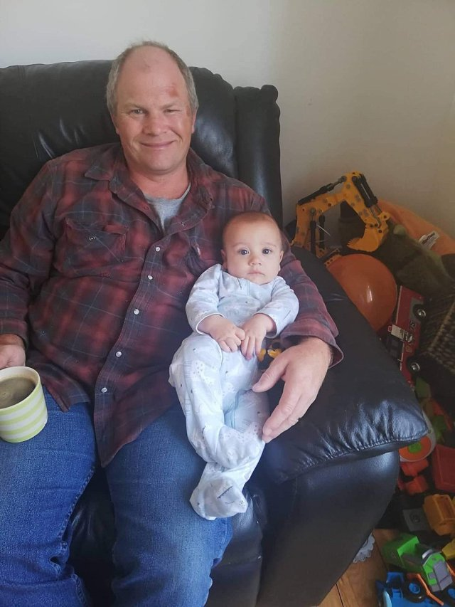 Chuck holding Monty in New Zealand.