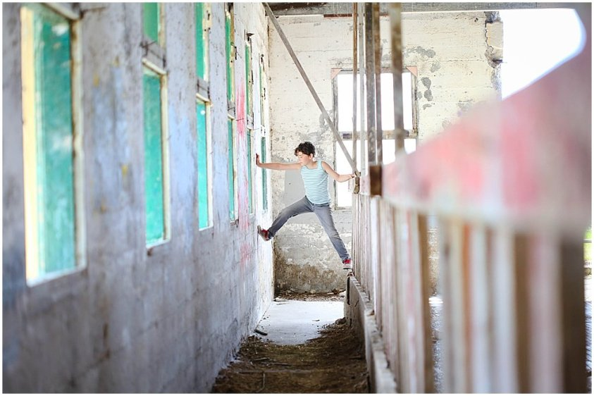 Apollo climbing in empty barn at Northern State Hospital.