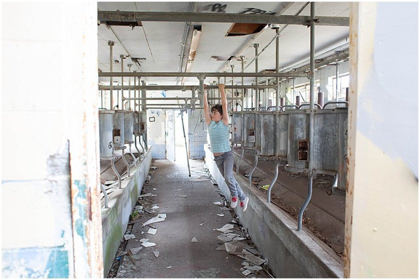 Apollo swings in an abandoned milking barn at Northern State Hospital.
