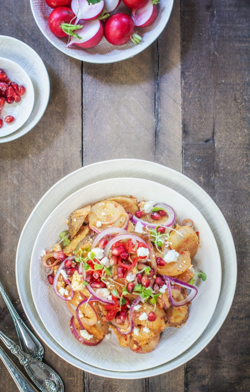 Overhead of Moroccan potato salad on wooden table