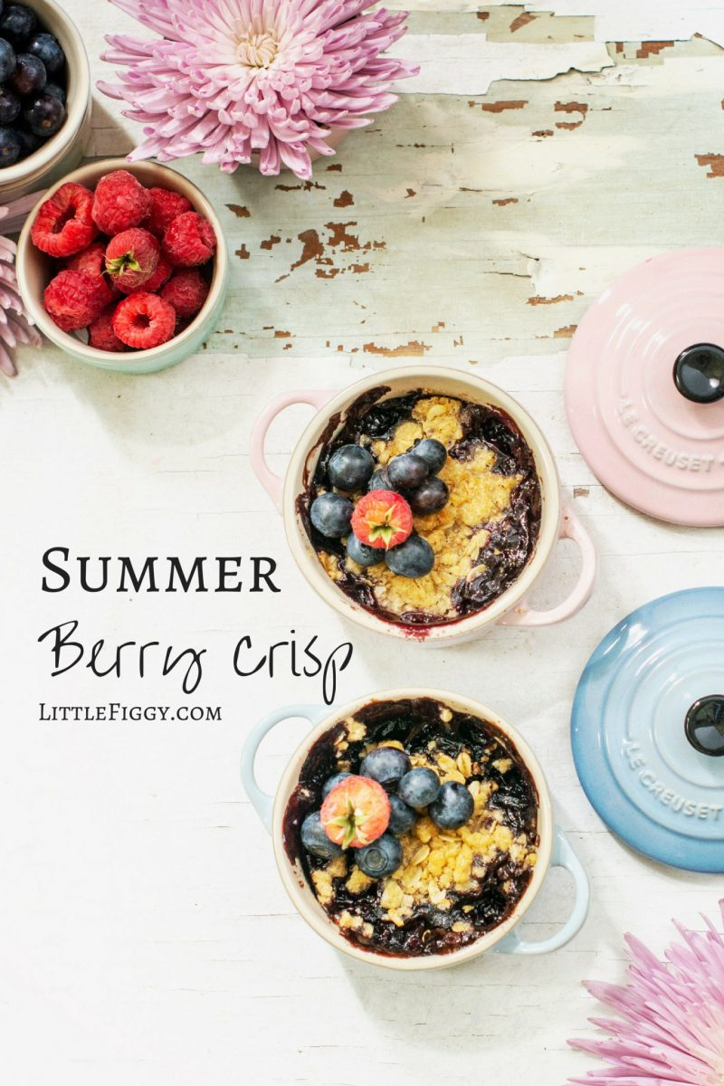 Summer berry crisp dessert in mini cocottes from Le Creuset, on a white background