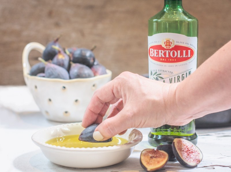 Fresh figs dipped in Bertolli Extra Virgin Olive Oil, then gently grilled to make a gorgeous grilled fig salad!