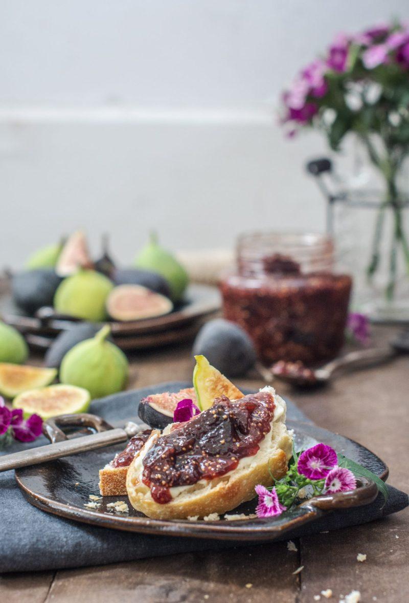 A fig jam recipe spread over a crusty piece of toasted bread.