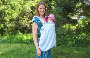 Sun baby carrier cover on a baby carrier