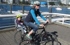 Summer baby carrier cover on an infant bike seat