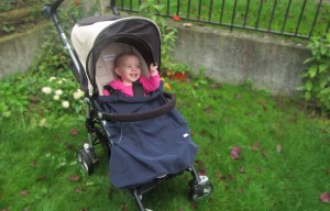Rain baby carrier cover on a stroller