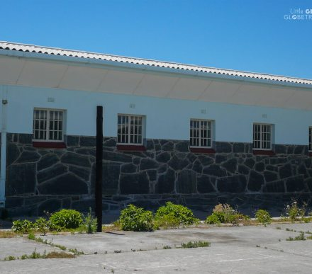 A line of cell windows taken from the outside of the Roben Island cell block in South Africa. Racism in South Africa prevails post-Apartheid.
