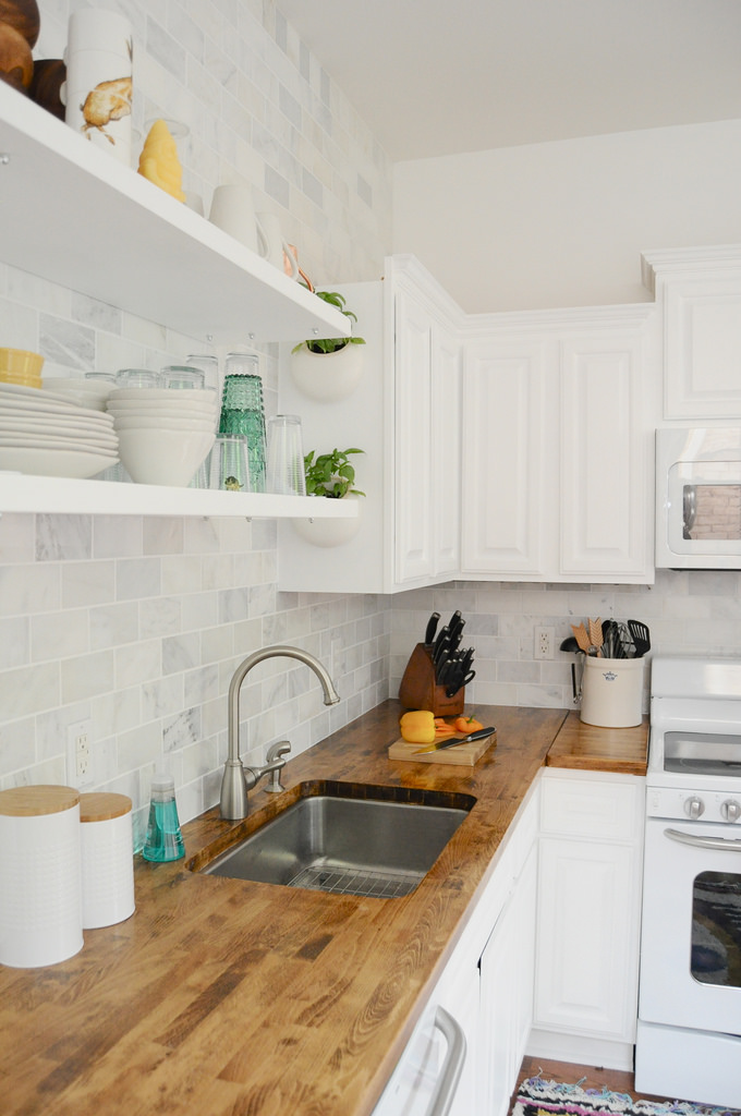 white appliances kitchen shallow cabinets as a design feature in the little house this classic has fresh feeling with marble subway tile dark butcher block counters and of course go