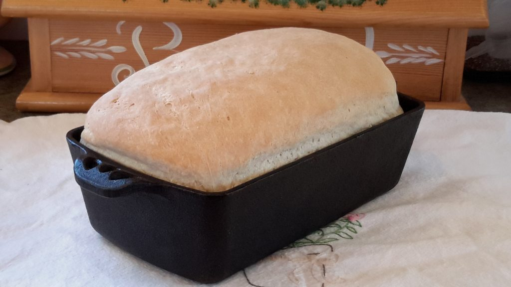 Bread cooked in a cast iron pan.