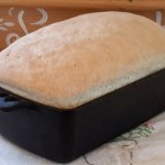 Homemade bread in a cast iron bread pan