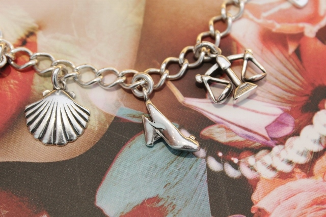 Silver Charm Bracelet: close up of Seashell, Shoe, Libra Scales