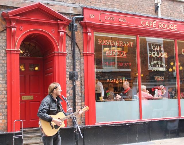 Busker outside Cafe Rouge in York