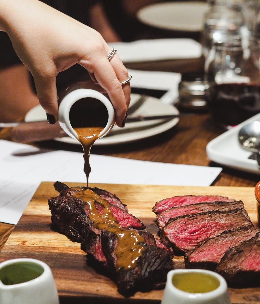 elk steak and peppercorn sauce