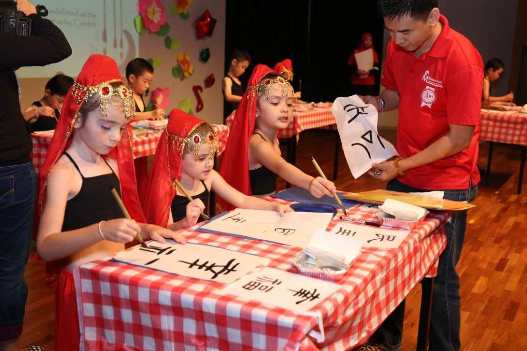Preschool Kids learn Chinese calligraphy in our East coast campus