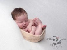 Newborn baby photography Hythe Kent baby asleep legs up