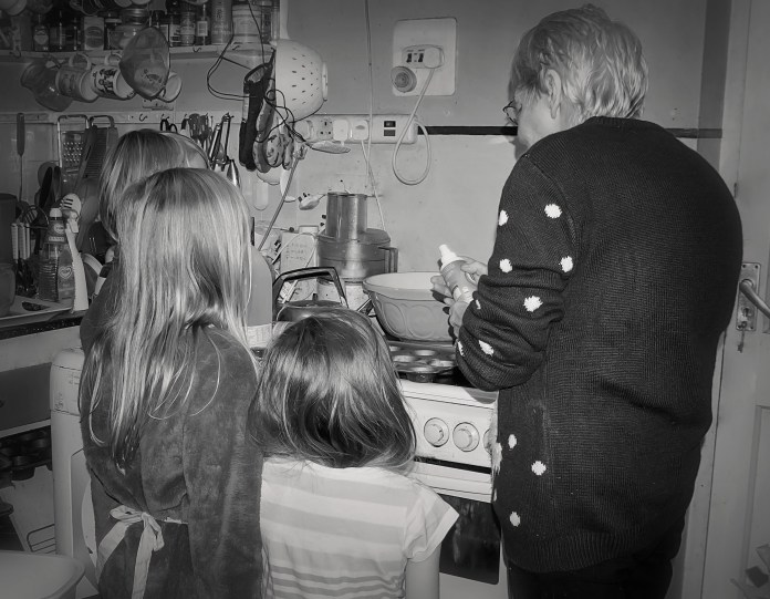 Children baking with grandmother